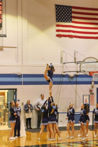 Mustang cheer team with flying high hopes as they tumble through the season