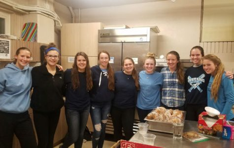 Softball team hits home-run with philanthropy project