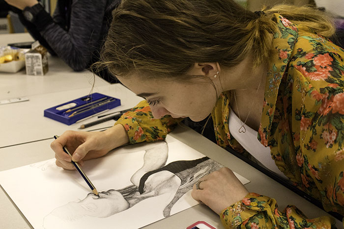 Celestyna Jarzabeck adds detail to her sketch.