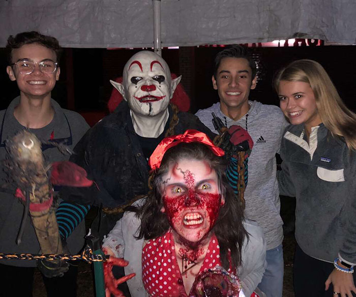 Blueprint members Alex Miranda, Jacob Casella and Sarah Barber posing with Midnight Terror actors Daisy and Orphan