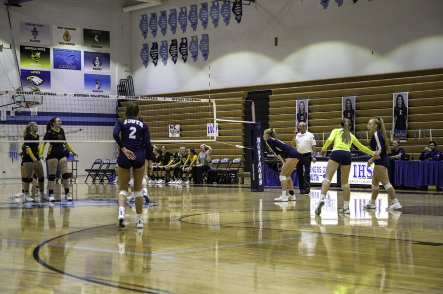 Varsity players wait for Hinsdale South to serve the ball.