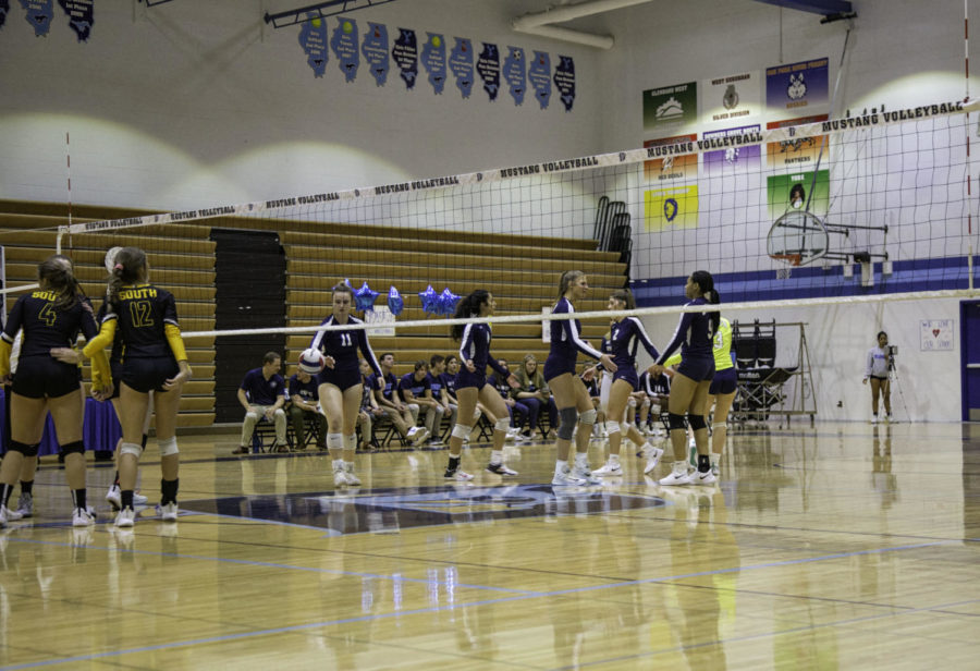 The DGS girls cheer on one another after a point is scored.