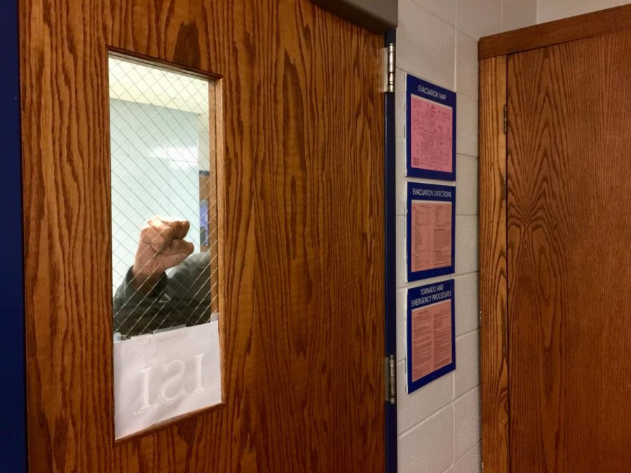 A stranger knocks on a classroom door.