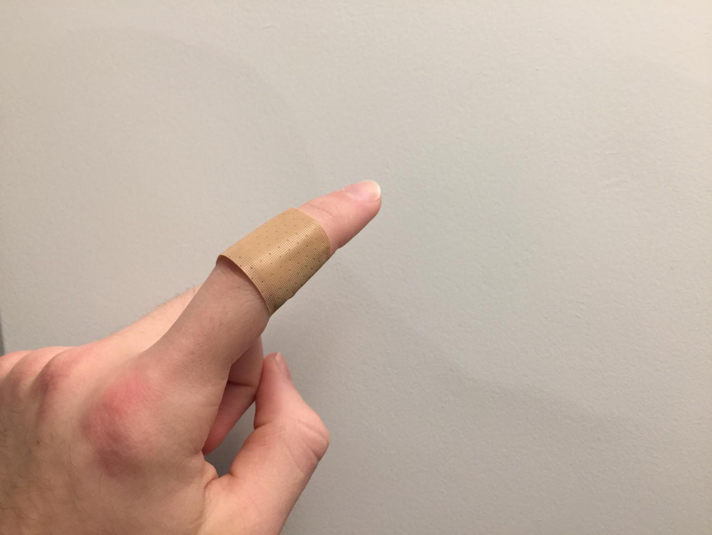 A standard bandage on a standard paper cut.