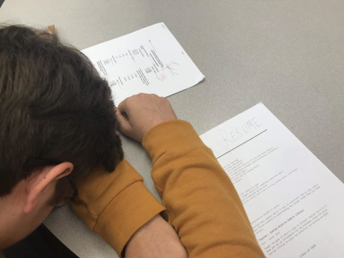 Student losing the battle against sleep over his homework and resume