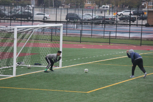 Varsity goalie at practice.