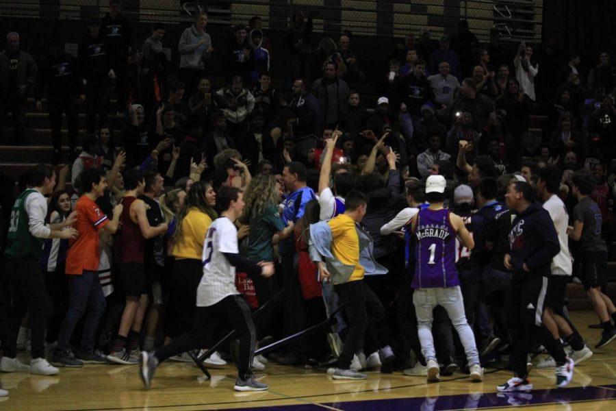 DGS fans celebrate as the last quarter buzzer sounds.