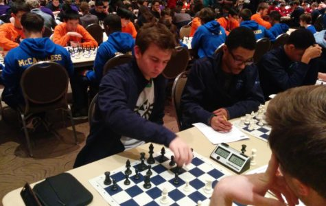 (Right) Junior Johnathon Leatherwood competes at the State Chess Tournament in Peoria, Ill.