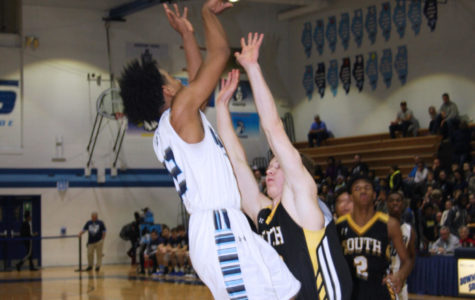 Senior Wesley Hooker goes up for a lay up against his defender.