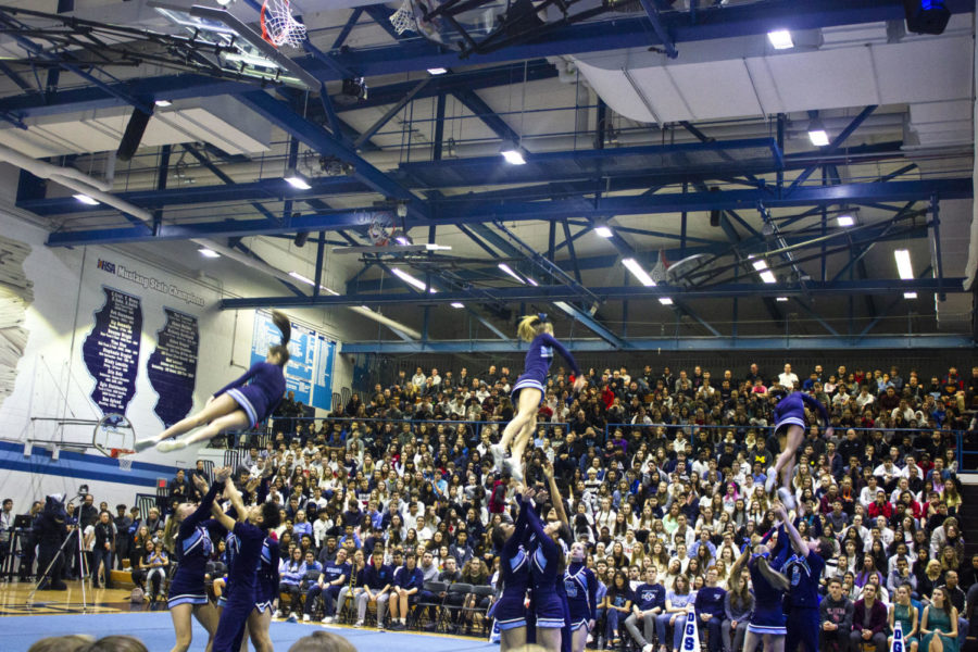 Varsity+cheerleaders+show+off+their+skills+during+the+spirit+assembly.