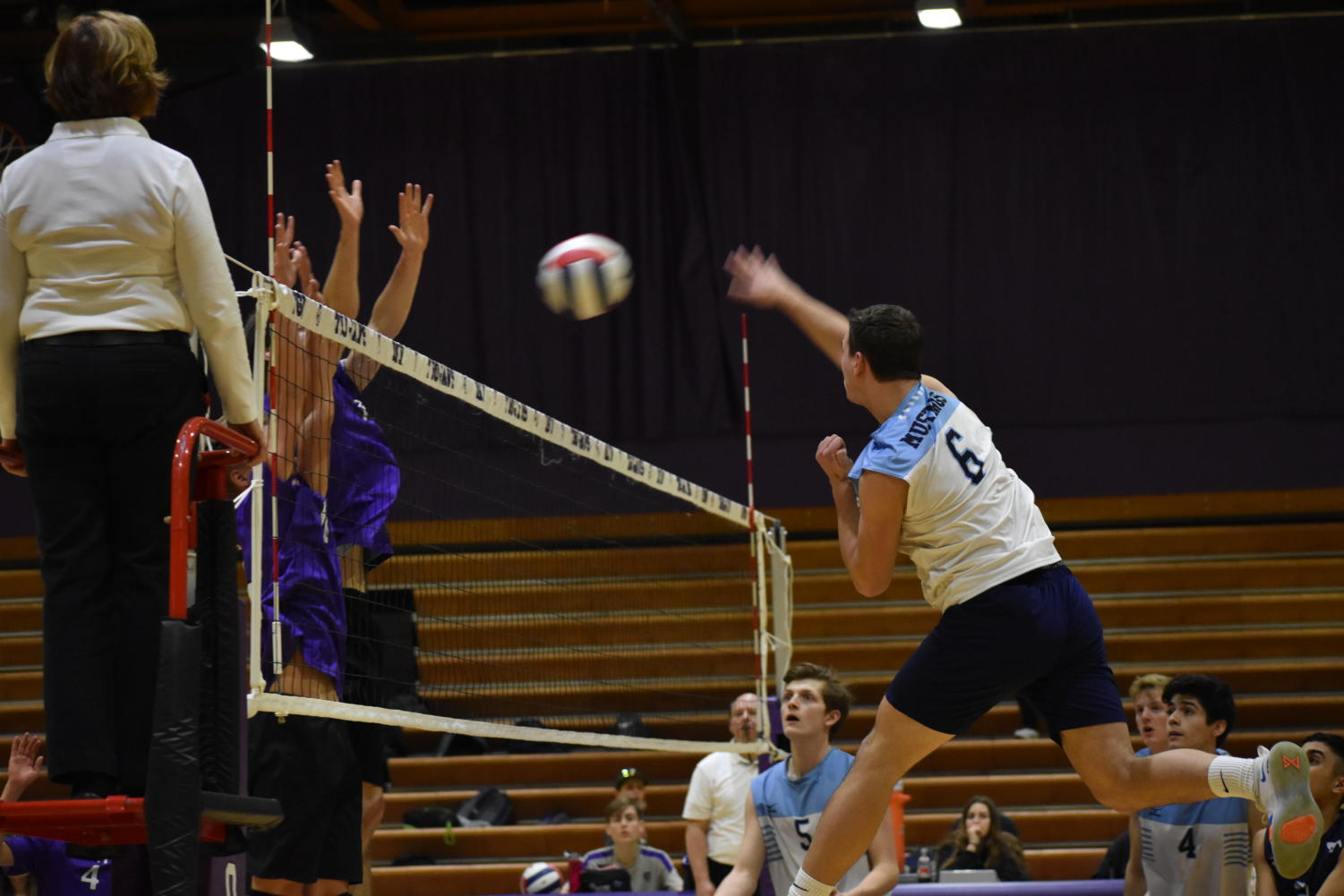 Senior Max Hlavin jumps to spike the ball at the other team.