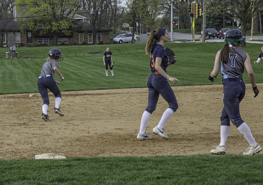 Two members of the team sprinting back to their bases to avoid being out.