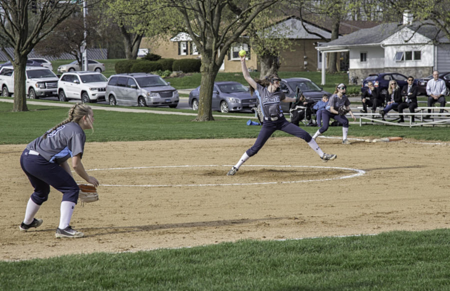 Delaney Madiar pitches the ball to try and strike out the batter.