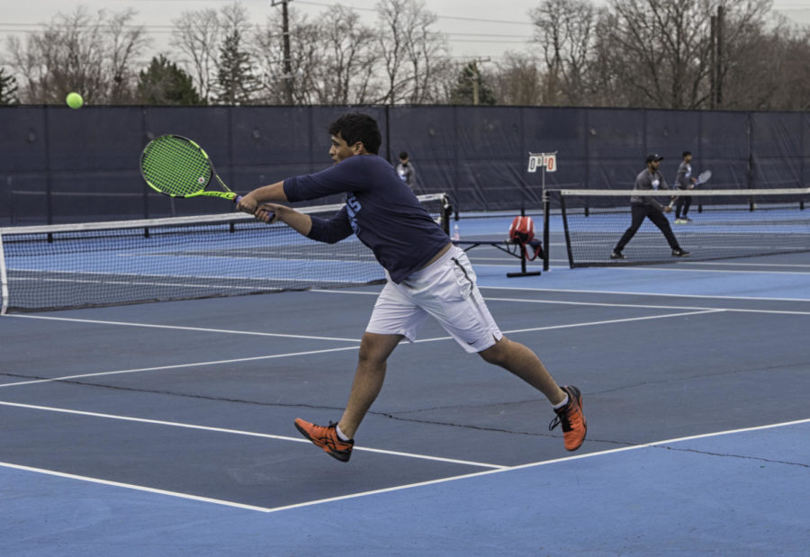 Junior+Tanuj+Singh+reaches+to+return+the+serve+from+his+opponent.