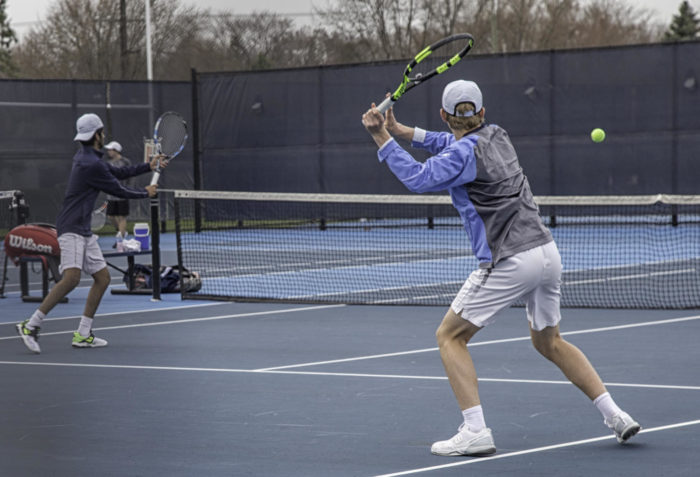 Senior Ryan Krakowiak prepares to return the ball while his partner Sushant Lala waits to hit any upcoming volleys.