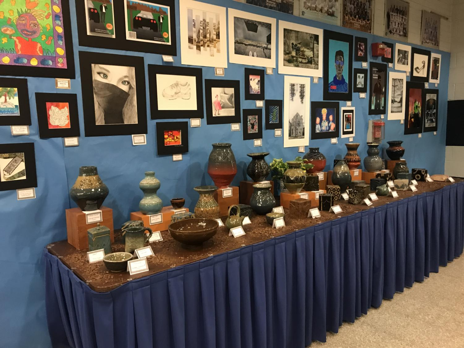Underclassman%27s+pottery+and+artwork+displayed+on+the+tables+and+walls.+