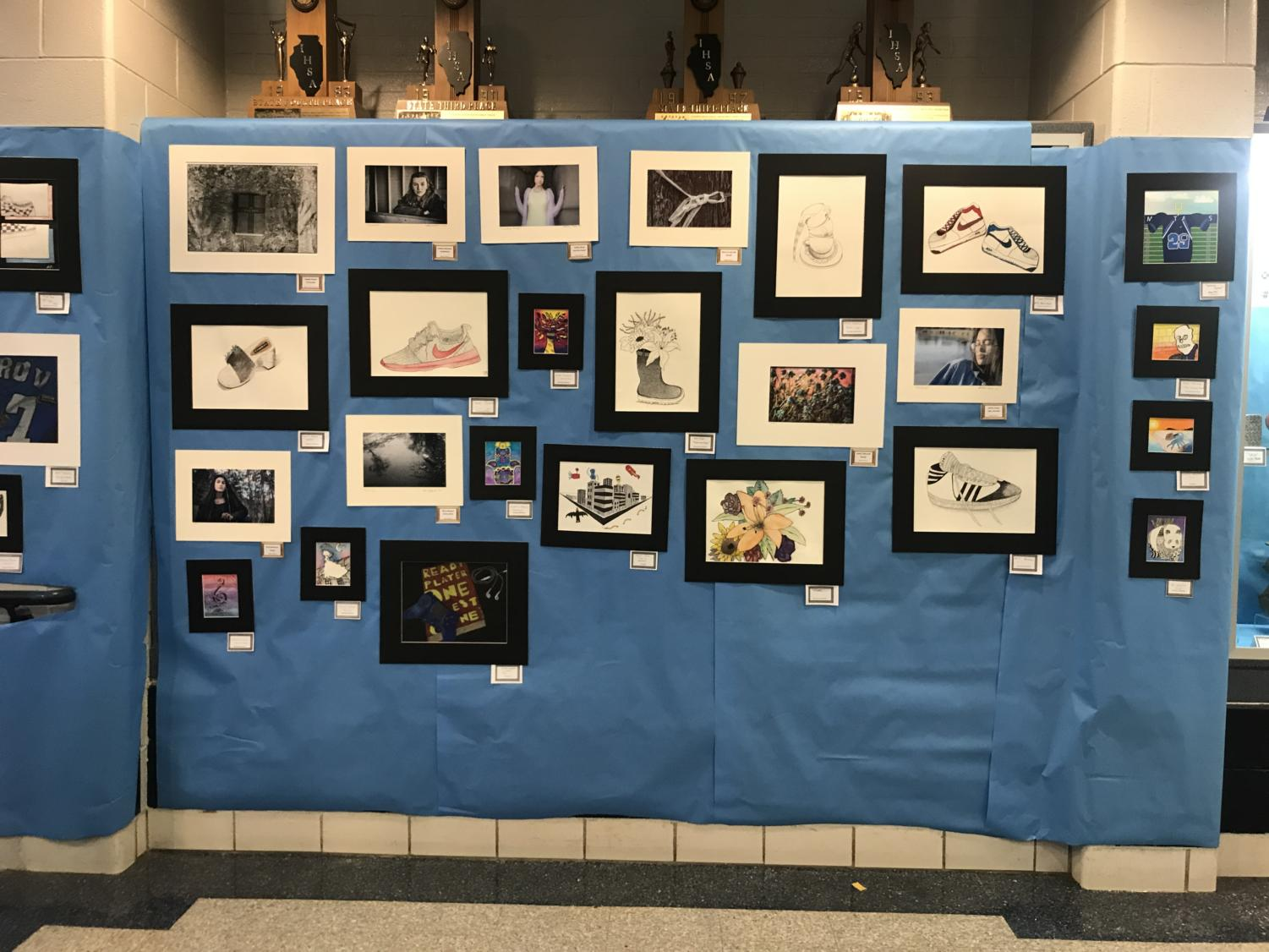 Artwork+from+underclassman+involving+photography%2C+design%2C+drawings+and+paintings.+