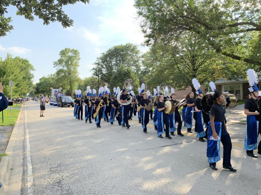 The marching band plays on as the parade comes to a close.