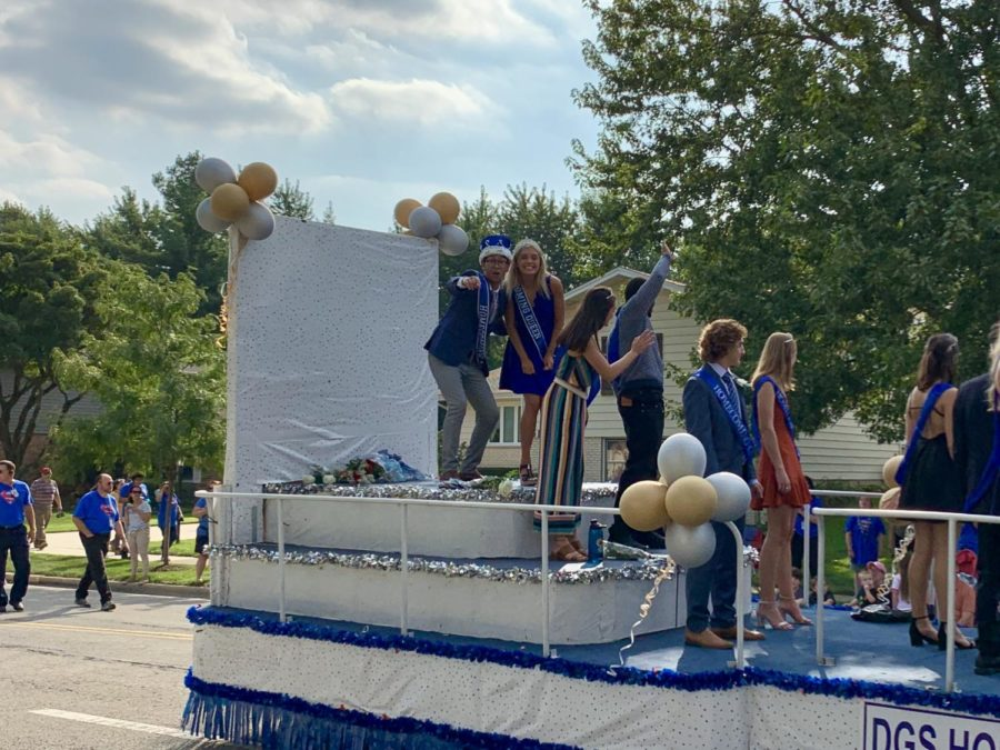 Homecoming king and queen Kevin Tate and Talia Davis wave to the crowd as the annual parade comes to an end.
