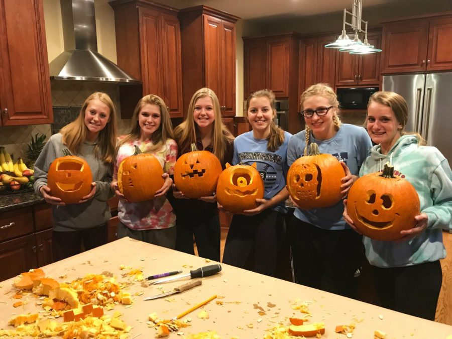 Josie Gadzala, Renee Maley, Allie Coyne, Sara Scolan, Teagan Smith and Julia Grippo carve pumpkins together to show their Halloween spirit.
