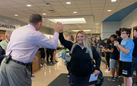 Brindza high fives Principal Edward Schwartz at her state send off at 7:30 a.m. on Oct. 17.