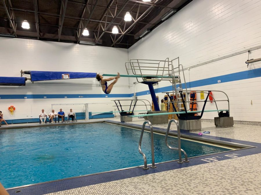 Emma Fudacz performs a back dive pike at her second meet of the season.