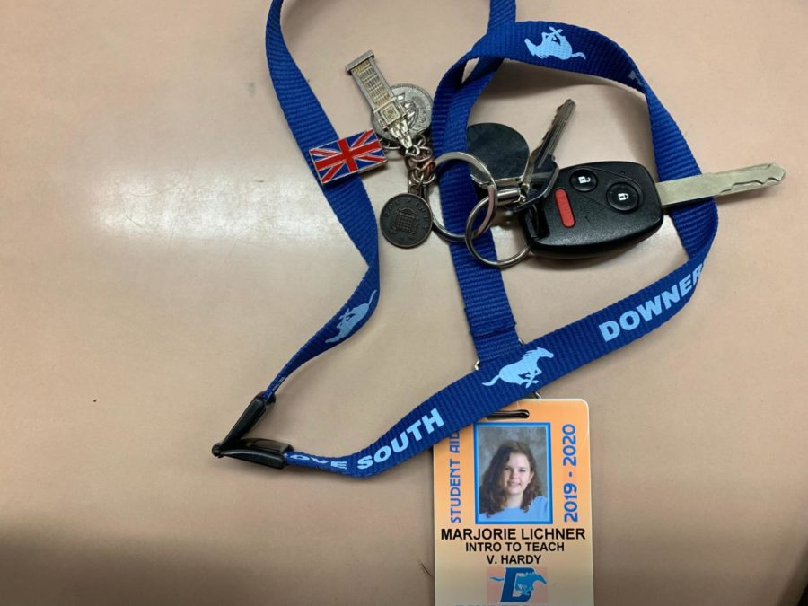 The Introduction to Teaching essentials when getting ready to go to their field schools, a name badge and car keys.