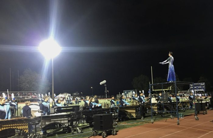 Junior drum major Jeffery Weinholtz leads the band during their show at the Music Bowl competition at DGS.