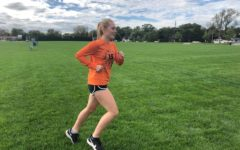 Kennedy Warden runs towards the end of her high school cross country career
