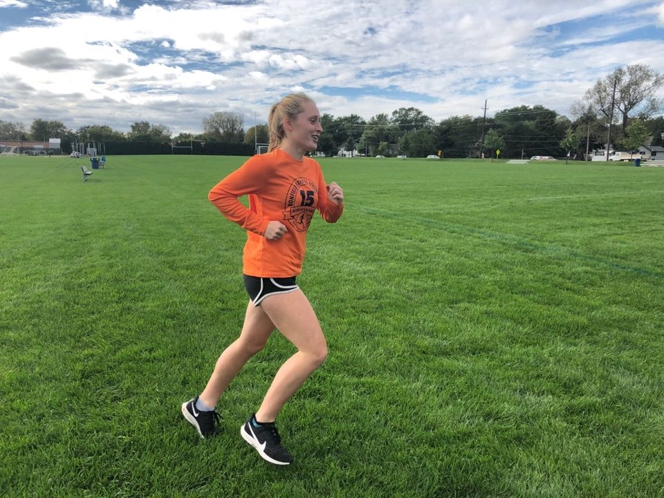 Kennedy Warden is practicing with her cross country team preparing for their next meet