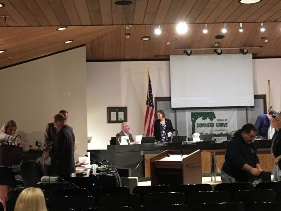 The village council members and Downers Grove residents conclude the meeting in the village hall.