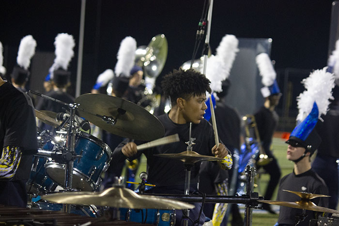 """Drummer Bri Backmam performs in the percussion section during the marching bands halftime performance entitled """"Reflection""""."""