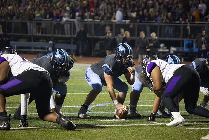 Senior offensive lineman Nick Rasnic preparing for a battle against the Trojans.  The Mustangs fought until the end to try and win the crosstown classic game.