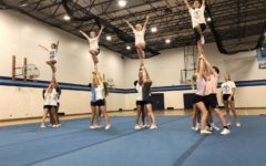 With competition season approaching, DGS varsity cheer tumbles into the weight room