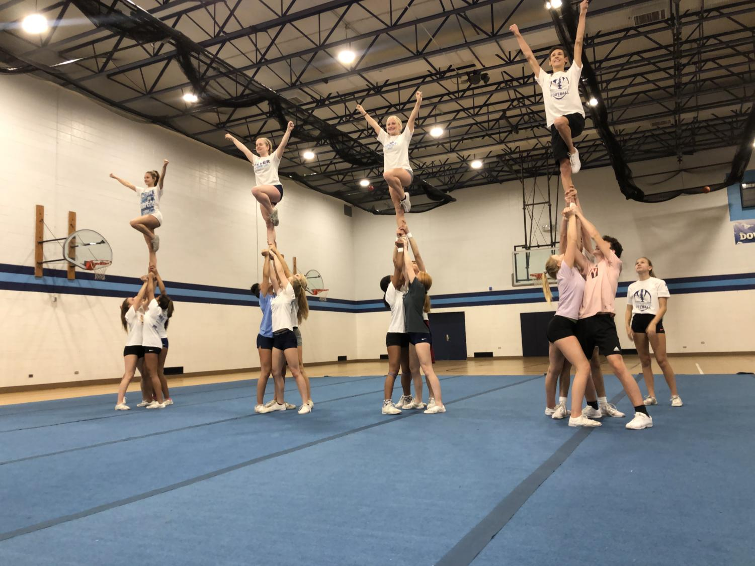 DGS varsity cheer team practicing stunting for their upcoming competition season.