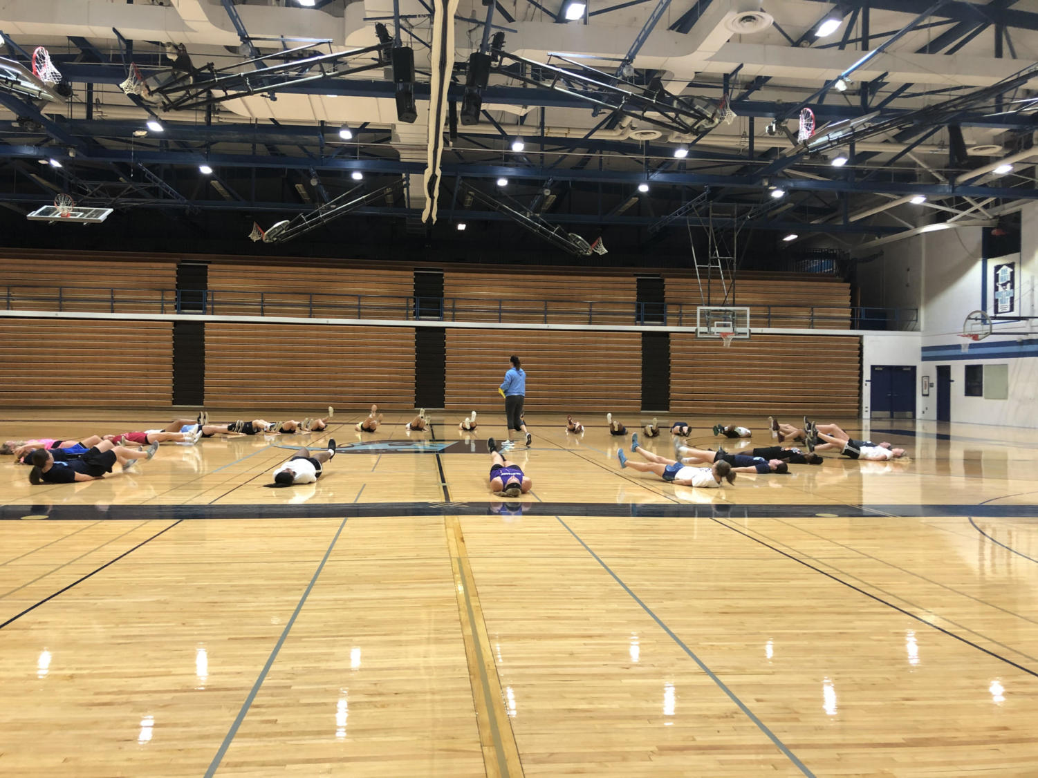 The girls varsity basketball team is preparing for their upcoming season with intense workouts, such as working on their core and endurance. The rigorous training will hopefully help them recover from losing two of their key players.