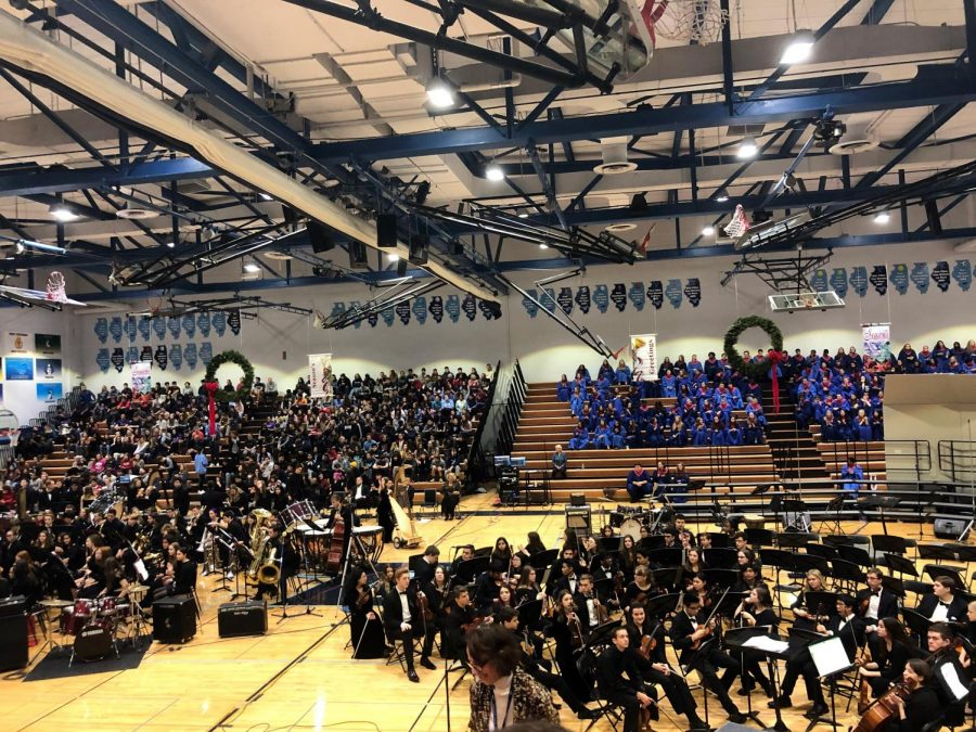 The D99 orchestra and the DGS combined choirs get ready for the start of another holiday assembly.