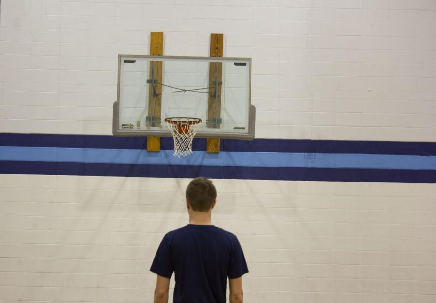 Cigrand deciding his method to shooting the perfect free throw.