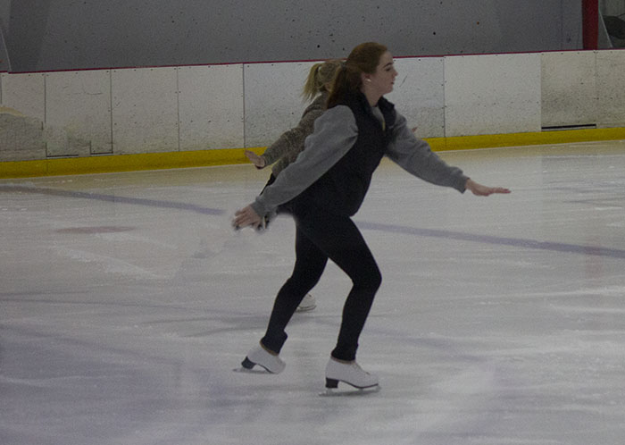 Lauren Gee glides across the ice during her skating practice.