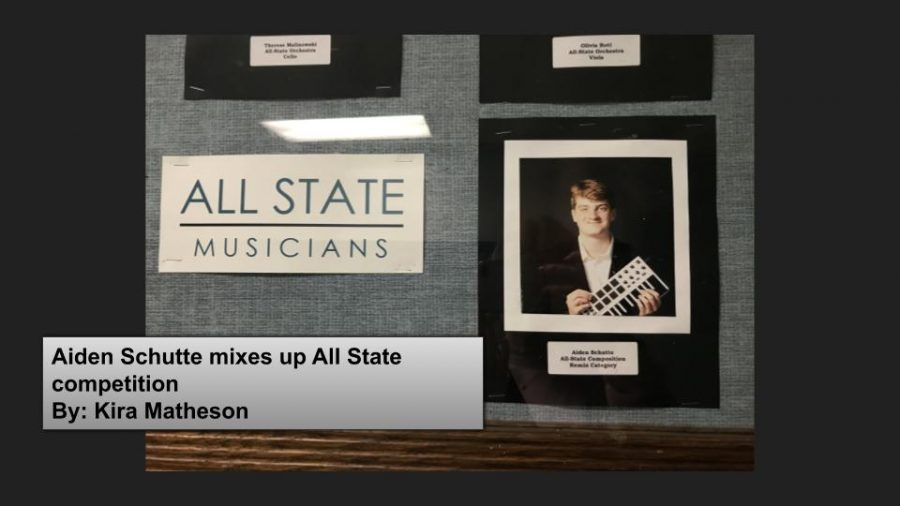 Aiden is featured in the IMEA case alongside other All-State musicians.
