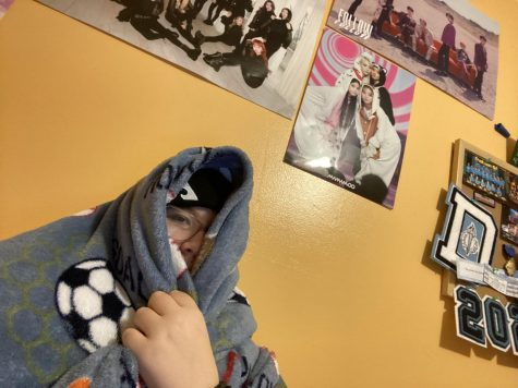 Me, at home, in a blanket, surrounded by K-Pop posters, not giving a care in the world about prom or really anything else.