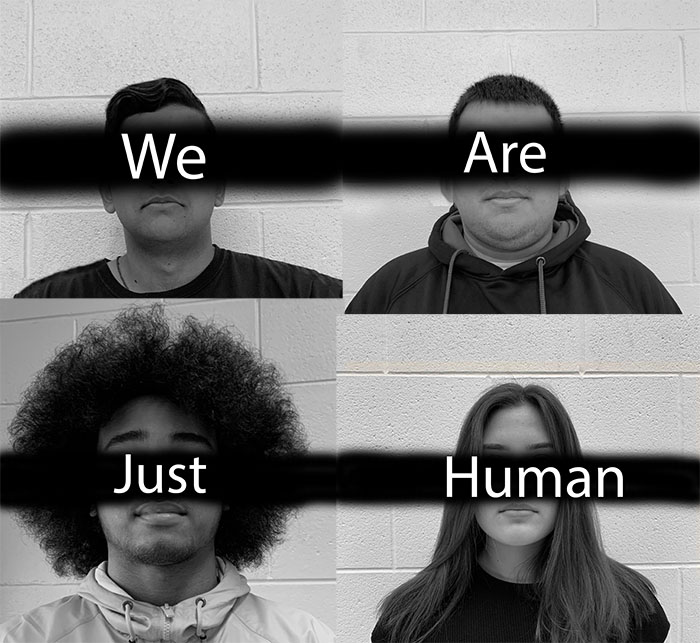 Students of difference racial backgrounds pose for photo-- we are just human.