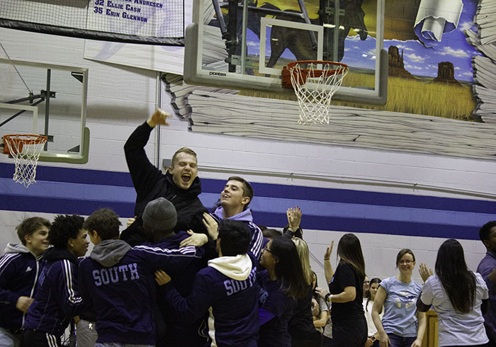 The varsity wrestling team hoists up one of their coaches after he participated in the staff tug of war competition against the juniors. The staff won the overall tug of war competition.