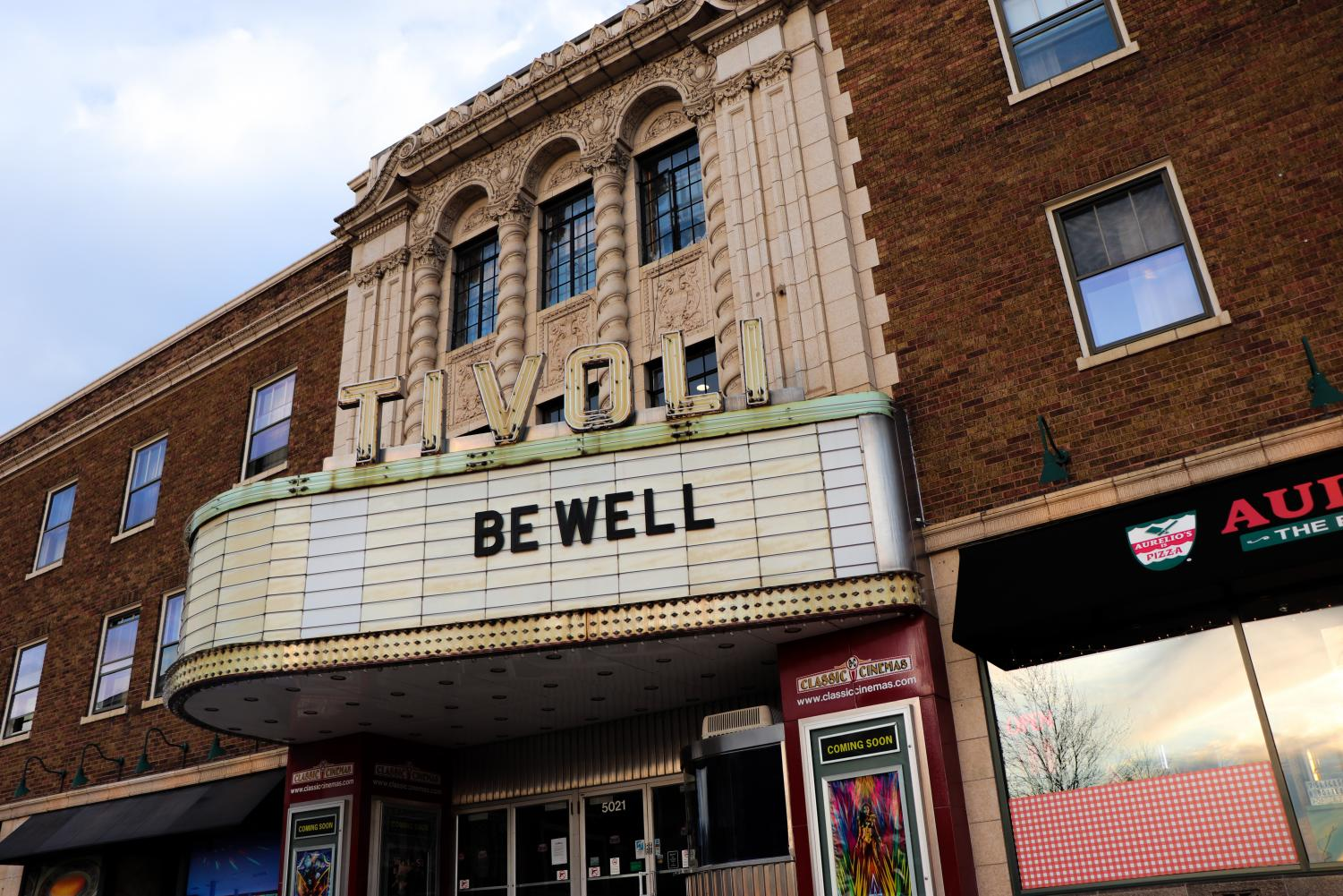 Constructed in 1928, the Tivoli Theatre in downtown Downers Grove is a community landmark and signature attraction among residents. The current facade of the theatre is a stark contrast to its typical lively marquee displaying nightly movie titles. Now desolate and lifeless, the Tivoli presents a singular message: be well.
