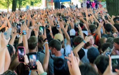 Hundreds of people surround a stage to watch Yung Gravy at Lollapalooza 2019.