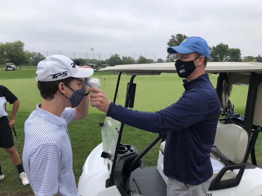 DGS golfer Logan Cochrane gets his temperature taken before starting practice