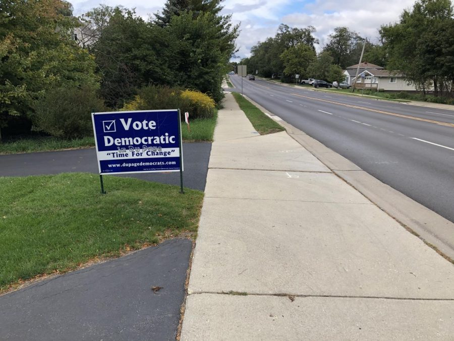Dupage residents encourage democratic party voting as seen here off of Main street.