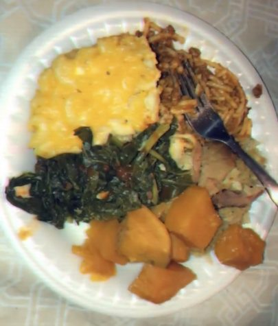 A picture of baked macaroni, dressings, candied yams, ham and spaghetti to celebrate Thanksgiving,