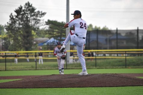 Star pitcher, Noah Edders winds up on the mound, ready to pitch the ball.