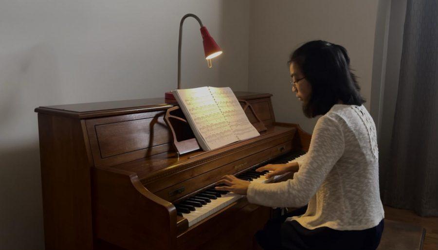 Urgello hones her skills on her Baldwin piano at home.